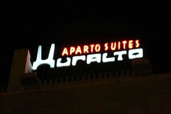 Aparto Suites Muralto : Hotel sign on top of building
