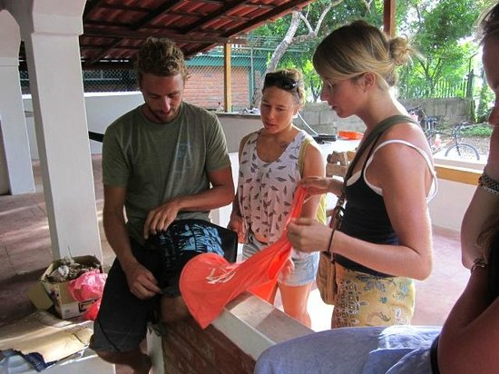 Papagayos: The girls from Papaya Grove asking Kai to design them some art work before we had opened our doo