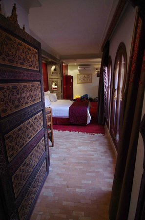 La Maison Arabe: The entry to the room with the bed.  The sitting area was beyond, around the corner to the right