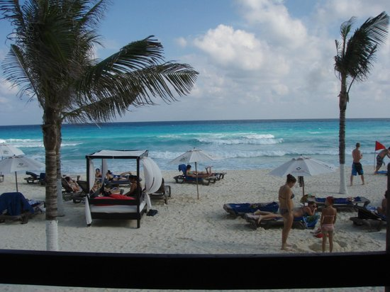 NYX Hotel Cancun: beach with beds,chaise and umbrellas
