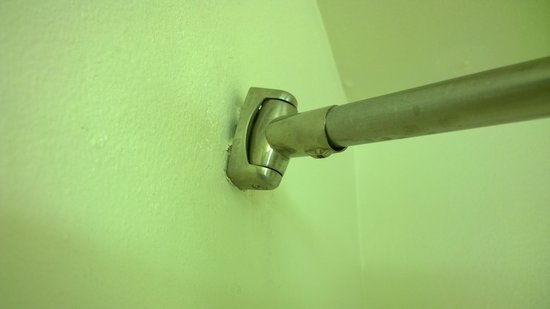 Clarion Inn : Shower curtain rod falling off the wall, causing the curtain to constantly open