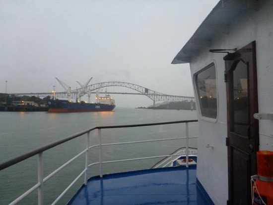 Canal & Bay Tours: Fantasia listing to port in Panama