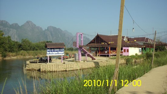 River View Bungalows: river view bungalow main entrance- back side bungalow with green pillars, the room where I was g
