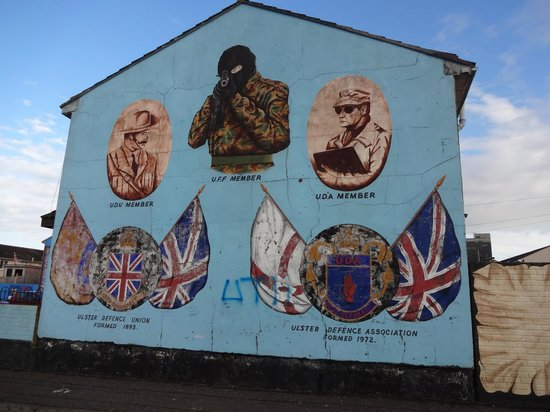 Paddy Campbell's Belfast Famous Black Cab Tours: This was my favorite mural, the shooter's eyes seem to follow you where you go.  Amazing.
