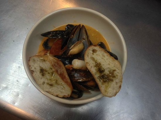Francisco's Caribbean Local Cuisine: Mussels, Shrimps and Chorizo in a Coconut Red Curry and Ginger Broth with Crusty Garlic Bread