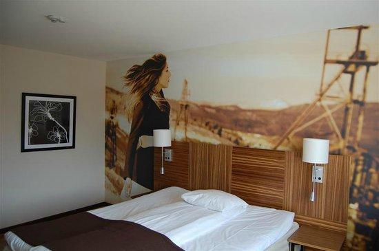 Comfort Hotel Eskilstuna: Wall art in my room.
