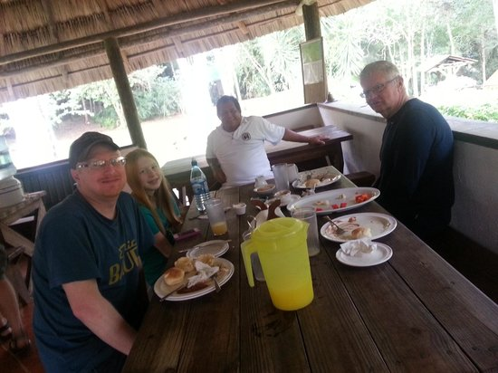 The Lodge at Chaa Creek: Us eating and visiting with Doseo, the caretaker of the camp.