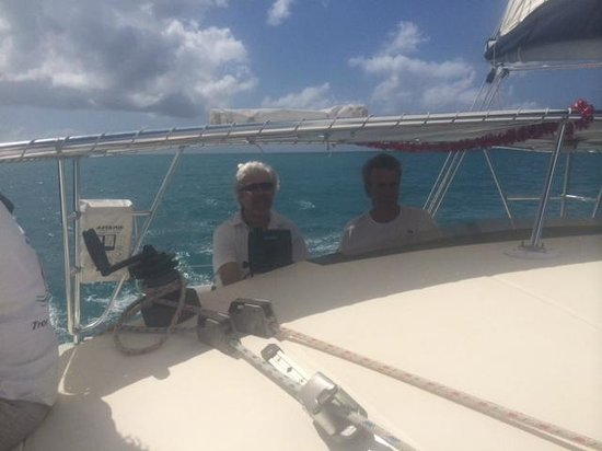 Tropical Catamaran Sailing Day Tours: Dale taking the helm