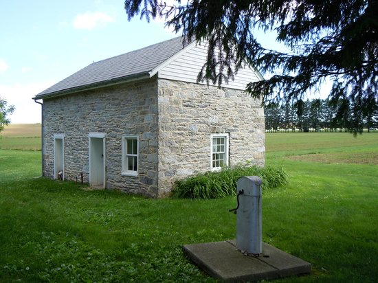 Pennsylvania German Cultural Heritage Center: The Summer Kitchen and well pump.