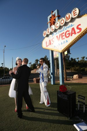 "Scenic Las Vegas Weddings Chapel: Niki and Mike dance to ""Love Me Tender"" sang by Mobile Minister, Roland August at the Las Vegas"