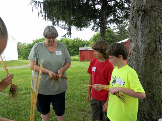 Pennsylvania German Cultural Heritage Center : Wheat weaving at Kid's Camp 2013.