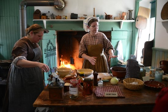 Pennsylvania German Cultural Heritage Center: Volunteer, Becky Manley demonstrating Hearth Cooking at Easter on the Farm 2013.