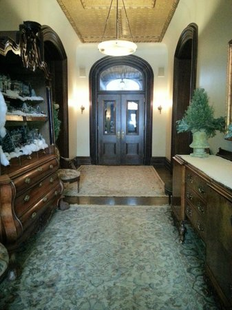 Wheeler Mansion : Beautiful entryway with antique furniture-and a little model of an old timey town for the holida