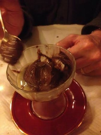 Chez Marcel: chocolate mousse with a chocolate shell, white chocolate sauce