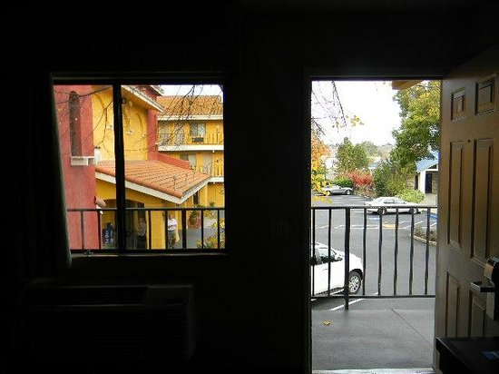Comfort Inn and Suites Rancho Cordova : view through front door and window during day with lights off