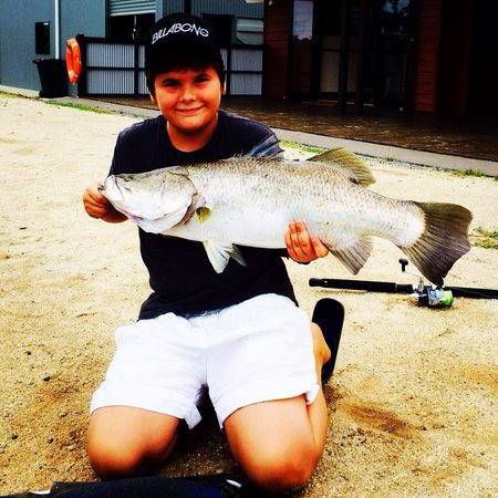 Hook-A-Barra: Dylan with his first barramundi