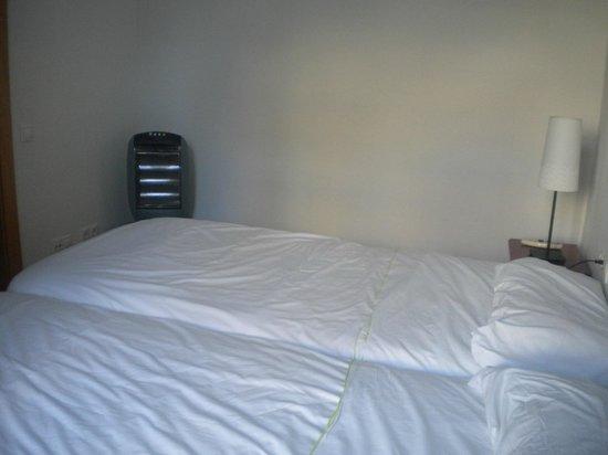 Happy Apartments: Stufa 1 camera da letto che tra un pò bruciava il piumone!