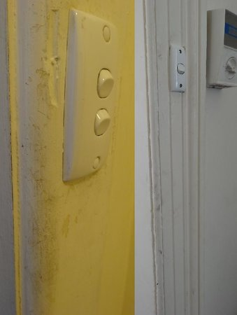 Magnolia Court Boutique: peeling paint and dirty door frame