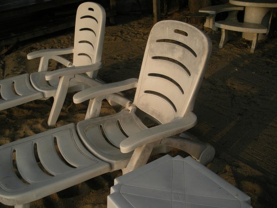"Samui Laguna Resort: see the "" black stains"" on these plastic  beach chairs, the back is very hard to ajust"