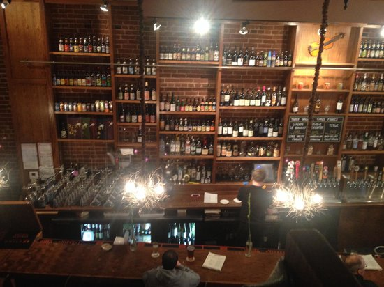 Bridge Tap House and Wine Bar : Wall of wine and beer selection.