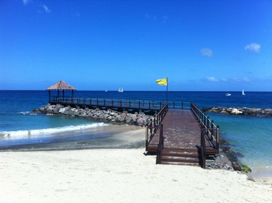 Sandals LaSource Grenada Resort and Spa: One of two walkways on the water