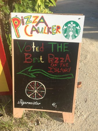 Pizza Caulker : The sign on front street