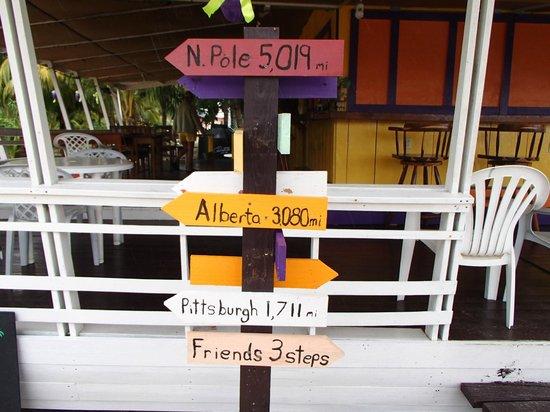 Friends Near the Pier: Sign infront of Friends