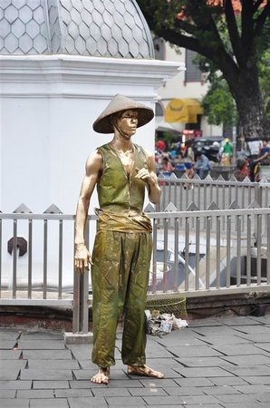 Jakarta Old Town: people who are dressed up such that they look like a statue. ....