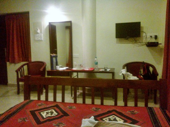 Pondicherry Executive Inn Pvt Ltd: The room with chair, table, wall television etc.