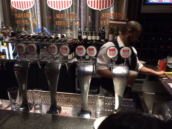 The Denver Chophouse and Brewery: Bar taps for beers made in house