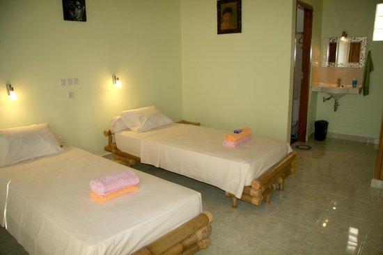 Puri Tugu Belanda : kamer met 2 bedden