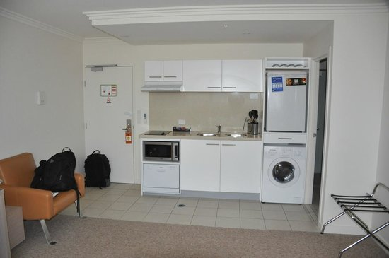 The Sebel South Brisbane: Kitchen area with washer/dryer