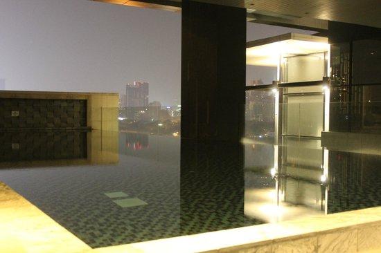 AETAS lumpini: pool at 9th floor, night view