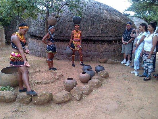 Shakaland: Demonstration of how to balance pot on your head.
