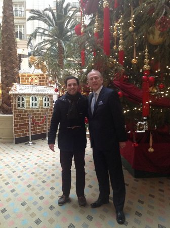 The Landmark London : my son & the manager Mr Andrew Batchelor in front of the impressive Christmas tree in the courty