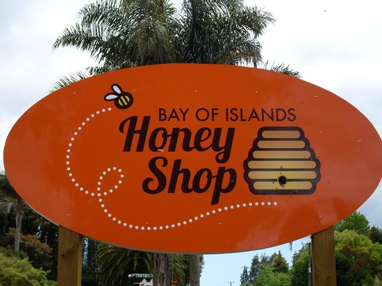 Bay of Islands Honey Shop: Look closely--our sign house a hive of live bees!