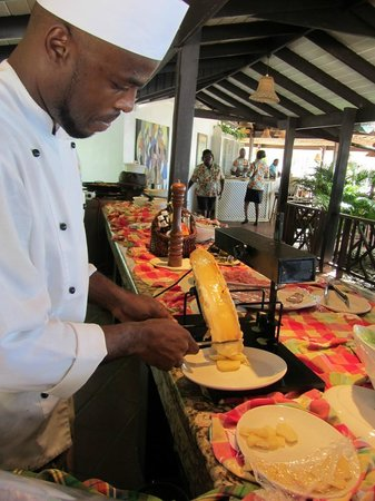 East Winds : Chef melting Roquefort cheese over potatoes