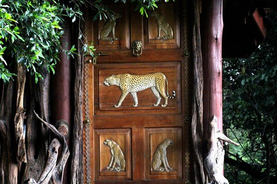 Royal Mara Safari Lodge: The hand carved door of our room.