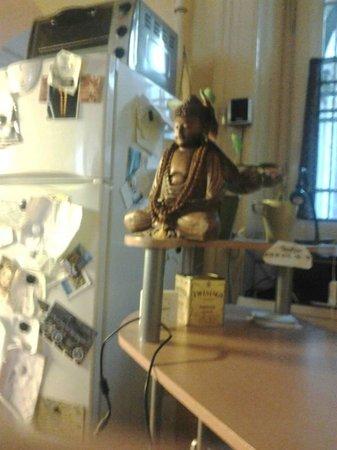 Guru Hostel: A receptionist desk and a fridge