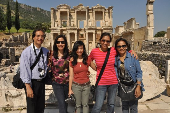 Ephesus Tours by OTTI Travel - Private Tours: At the Library of Celsus. Photo taken for us by Banu Akin.