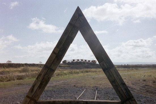 Lough Boora Parklands : bog train seen thru pyramid (it's still there, but this photo was taken October 2002)