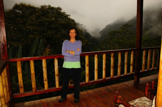 San Jorge Eco-Lodge & Botanical Reserve: Tamara outside our room at Tandanyapa at twilight.
