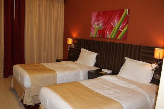 Abidos Hotel Apartment Dubailand : Camera da letto doppia