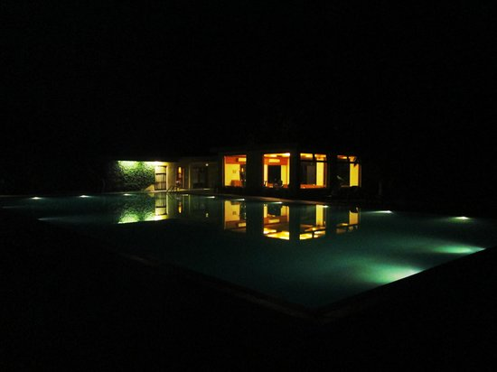 Sinclairs Retreat Dooars, Chalsa: pool spa gym at night
