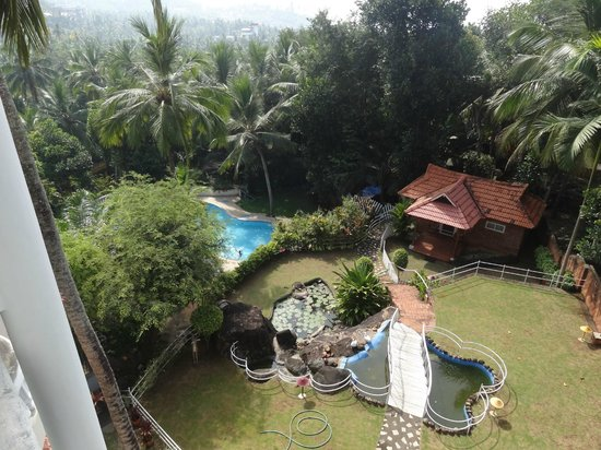 Swagath Holiday Resorts: Pool and garden from rool top restaurant