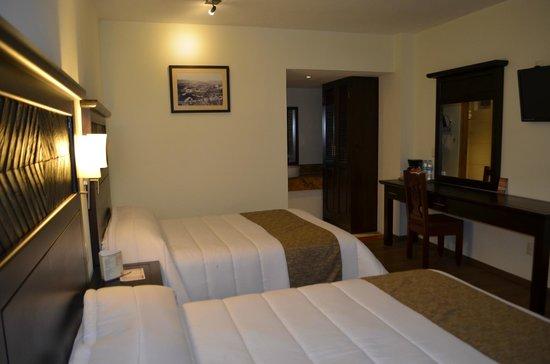 Plaza Magnolias Hotel : Habitacion