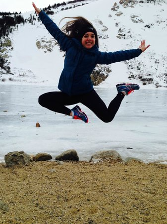St. Mary's Glacier: Daughter Jumping in front of the Frozen Lake - we made it!