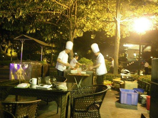 Royal Garden Hotel: outside,  hotel yard, street food