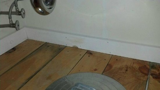 The Trailside Inn: hole in wall, you can see into adjacent room