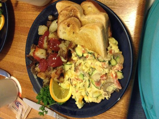 Walnut Avenue Cafe: Scrambler with zucchini, tomatoes, mushrooms and cheese.  Home fries are to due for!